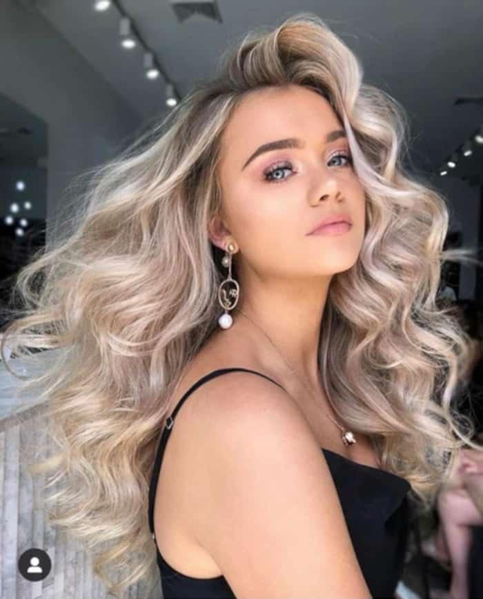 Glamorous Hair Looks That'll Get You Through Wedding Season voluminous curly hair