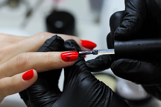 How-Getting-Your-Cosmetology-School-Degree-Can-Be-Great-For-Your-Career-woman-getting0her-nails-done-closeup
