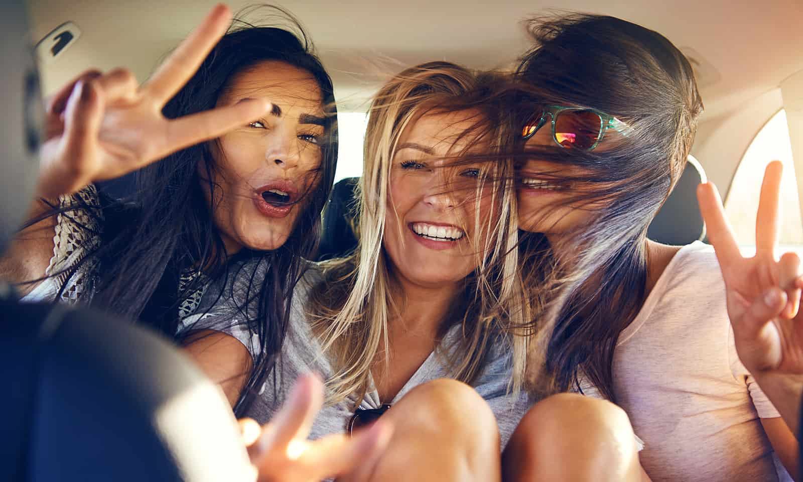 How-to-Revive-Damaged-Summer-Hair-girls-enjoying-the-summer-in-a-car-main-image