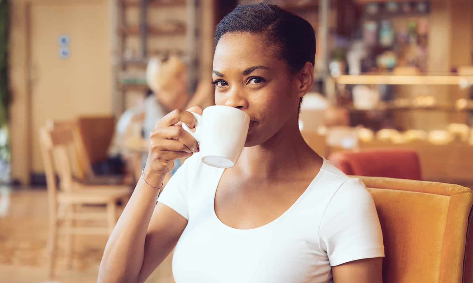 Natural-Ways-to-Relieve-Menstrual-Cramps-main-image-woman-sipping-tea