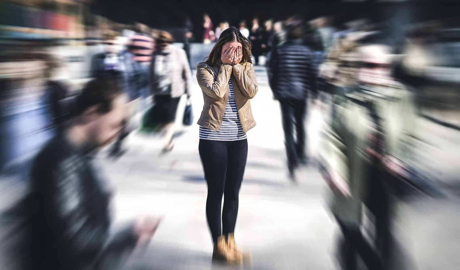 Panic attack in public place. Woman having panic disorder in cit