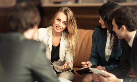 woman-conducting-business-meeting