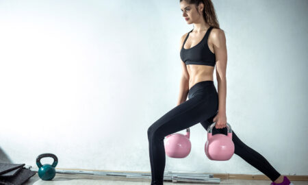 woman-working-out-with-eights