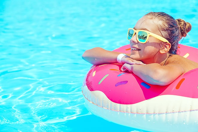 3-Ways-to-Make-the-Most-out-of-Your-Travels-girl-sunbathing-on-float-in-the-pool