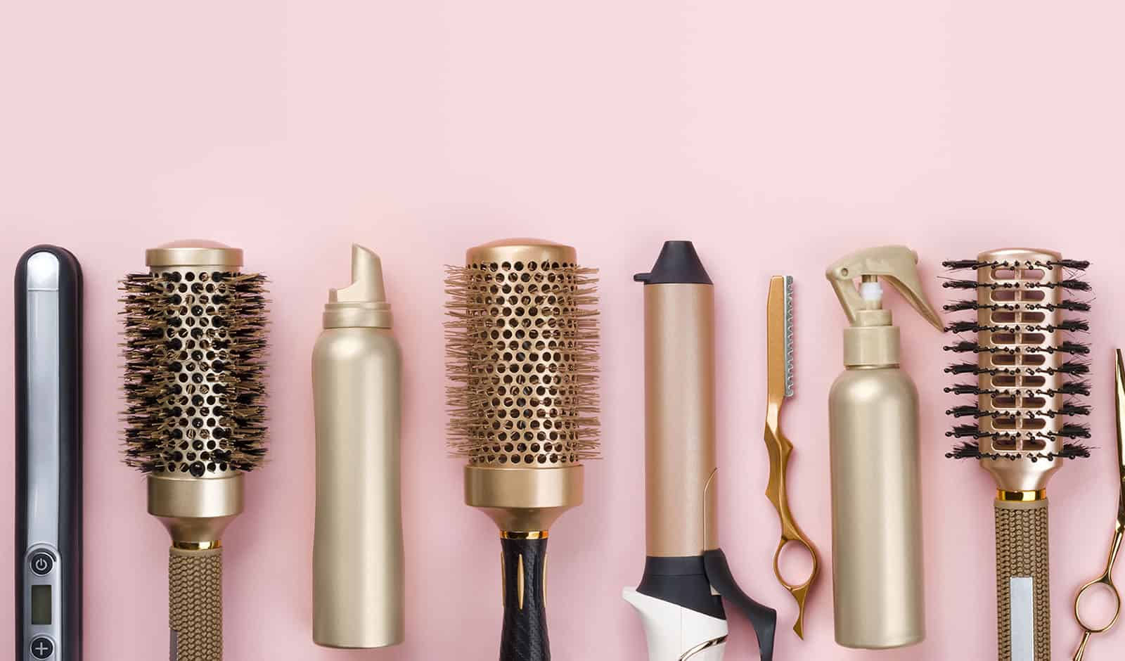 Professional hair dresser tools on pink background with copy spa