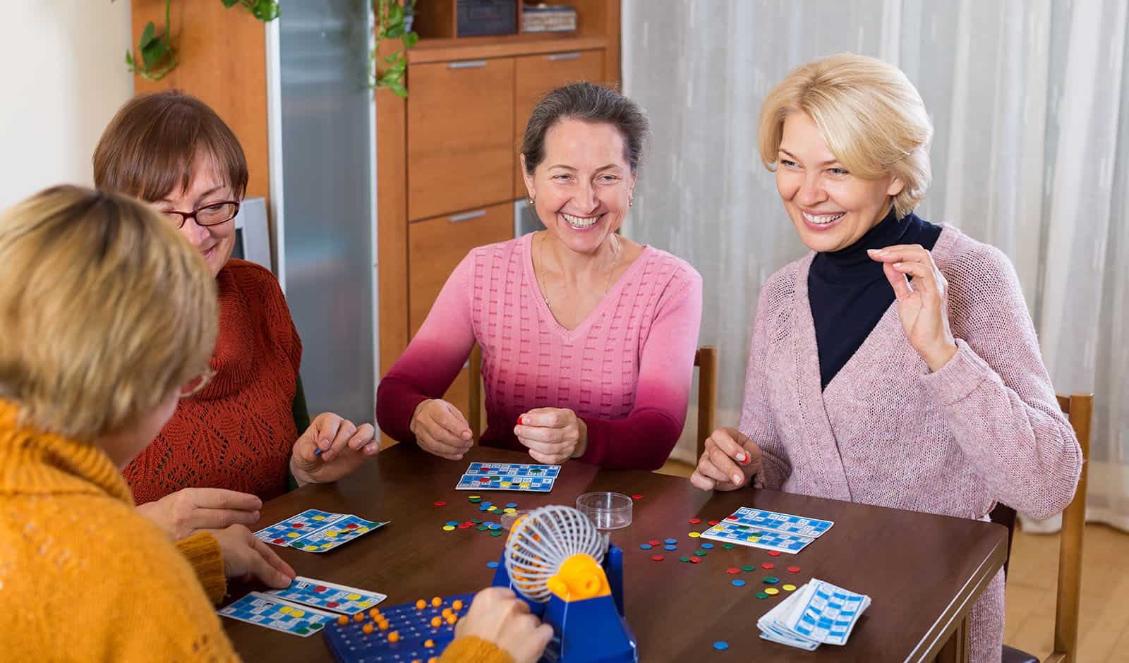 Pensioners playing board game