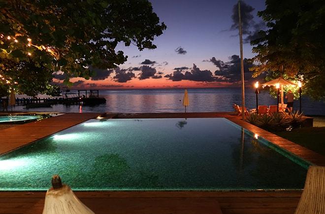ibagari-boutique-hotel-luxury-destination-roatan-honduras-night-pool-view-viva-glam