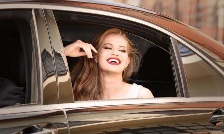 woman-in-car-window-smiling