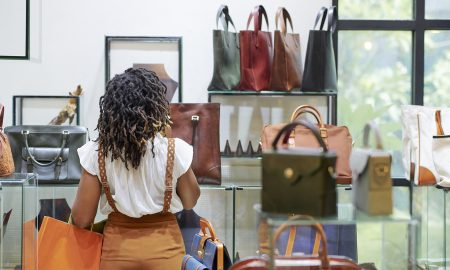 Woman looking at bag on shelves