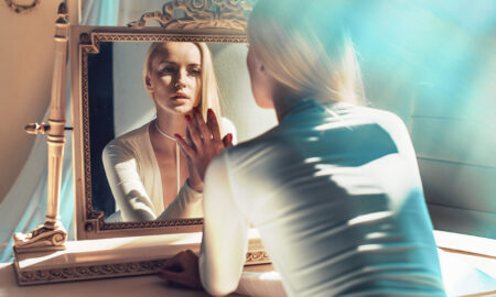 are-you-leaving-yourself-too-vulnerable-woman-looking-in-mirror-main-image