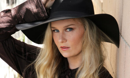 malorie-mackey-malories-adventures-weird-world-adventures-travel-headshot-western-style-photoshoot-main