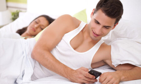 why-do-people-cheat-how-to-remedy-cheating-man-texting-someone-else-in-bed