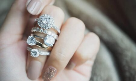 Silver-rings-for-women-main-image-woman-with-many-rings-on-her-finger