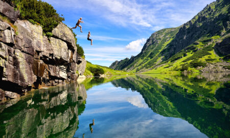 how-to-create-adventure-anywhere-main-image-couple-jumping-into-lake