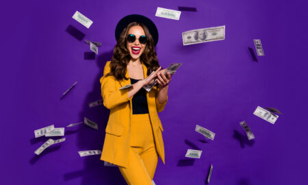 is-it-possible-to-win-online-slots-woman-in-yellow-raining-money-purple-background