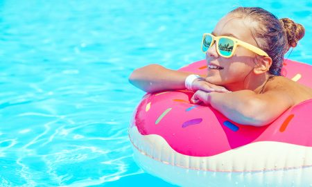 veganize-your-summer-accessories-main-image-woman-in-pool-in-donut-floatie