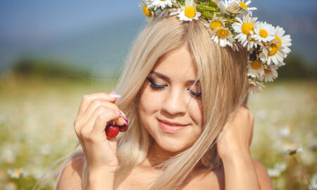 love-and-hope-whispered-in-my-ear-main-image-happy-girl-wearing-flower-wreath-in-field-main-image