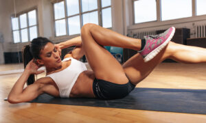 exercise-without-a-gym-membership-woman-working-out-doing-crunches