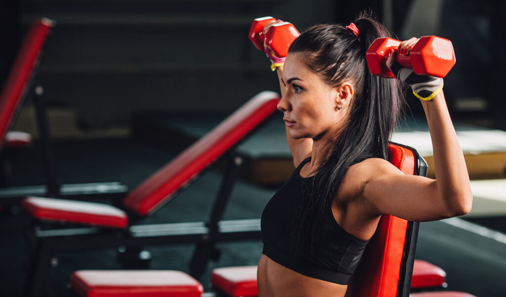 foods-and-exercises-you-should-do-to-build-muscle-and-lose-fat-woman-lifting-weights