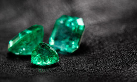5-facts-about-emeralds-people-dont-know-three-emeralds-on-black-background