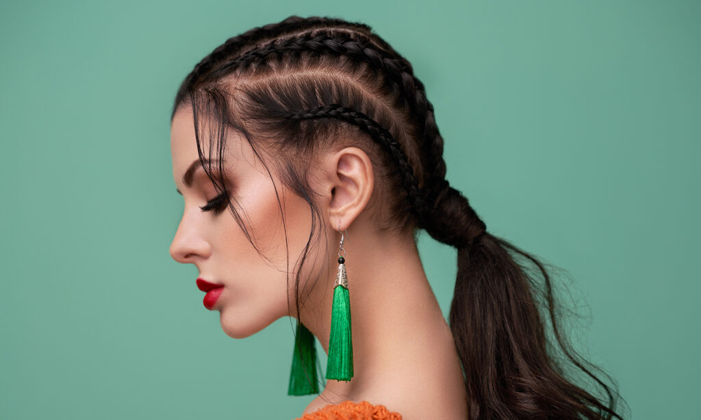 How-to-get-gorgeous-hair-natural-haor-remedies-woman-with-braids-against-green-background