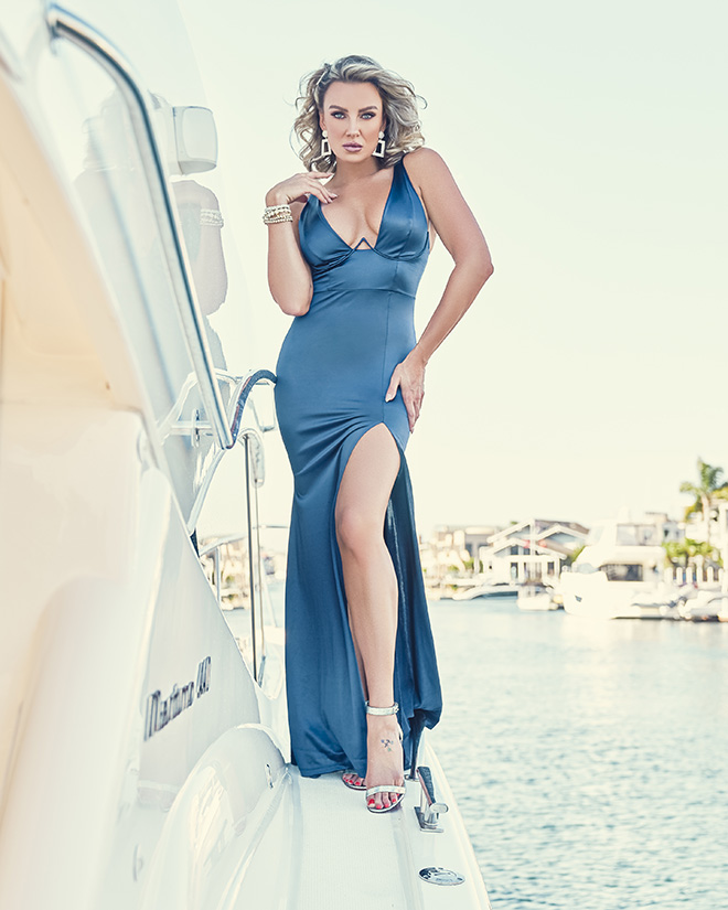 amber-nichole-miller-Shawn-Ferjanic-photoshoot-model-leaning-against-boat-in-blue-dress-image-5
