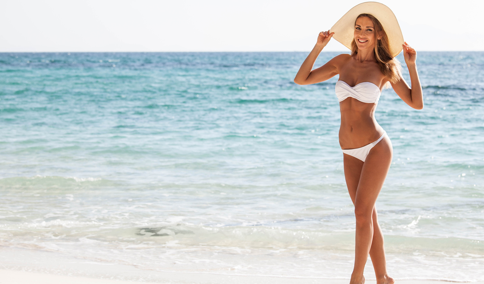 how-to-make-your-man-worship-you-woman-in-hat-on-beach-confident
