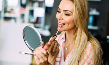 try-a-lipmask-right-now-woman-applying-lip-gloss
