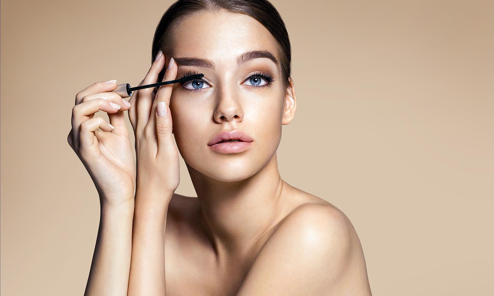 ethical-guide-to-false-lashes-woman-applying-mascara-main-image