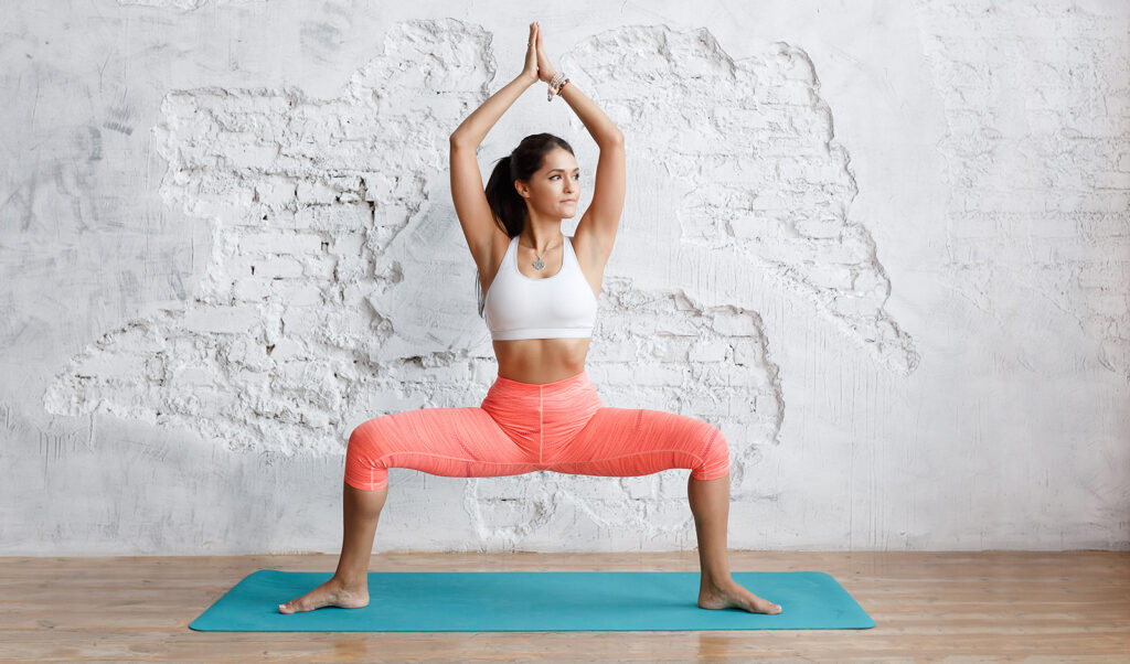 exercises-for-a-perfectly-shaped-butt-woman-exercising-in-pink-pants-indoors
