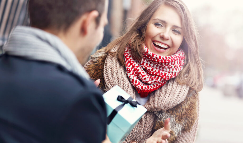 gift-giving-guide-for-every-occasion-man-giving-woman-gift-main-image