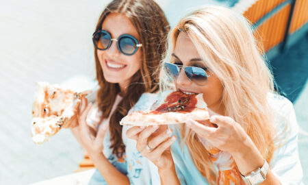 why-most-of-us-shouldn't-be-gluten-free-beautiful-women-eating-pizza
