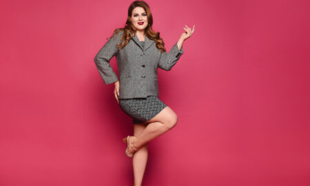 accentuating-your-looks-with-formal-suits-tips-for-the-plus-size-woman-girl-in-suit-pink-background