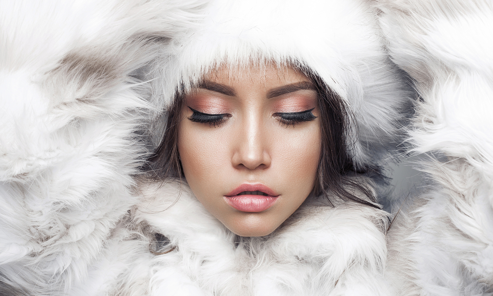 cbd-and-beauty-cbd-on-the-skin-woman-with-flawless-skin-in-winter-attire