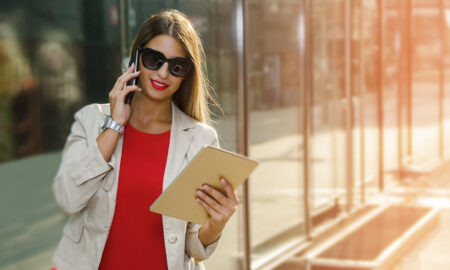 end-of-tenancy-checklist-woman-on-phone-looking-at-list