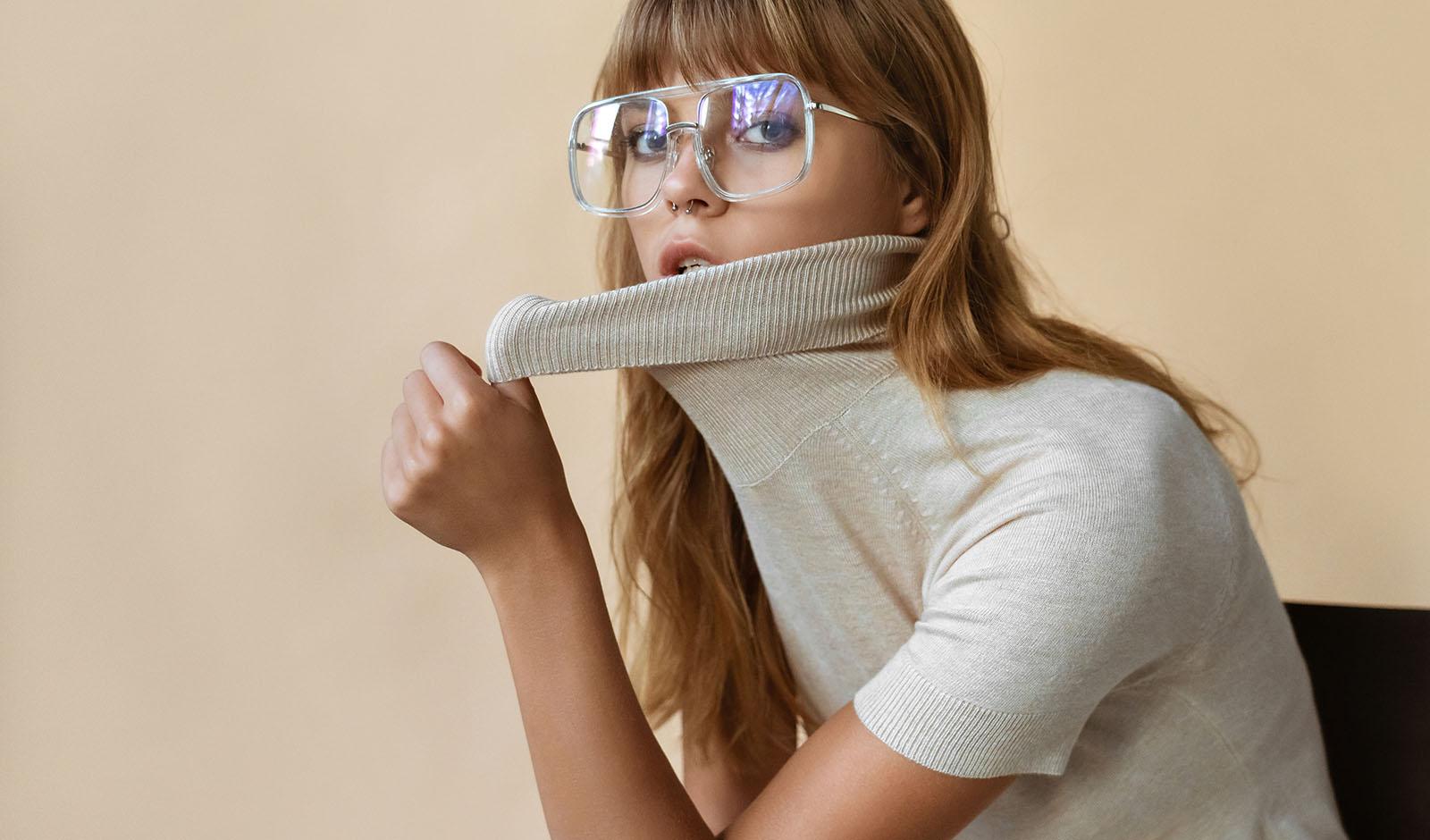 Stylish beautiful fashion girl wear trendy sunglasses looking at camera.