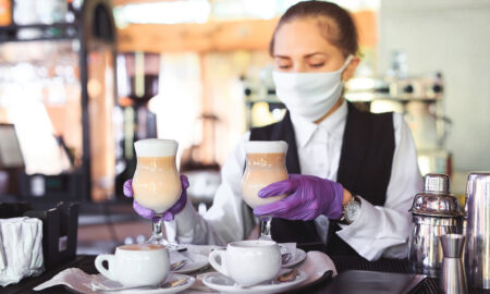 restaurant-owners-and-workers-face-desperate-times-woman-in-coffee-shop-in-mask-1