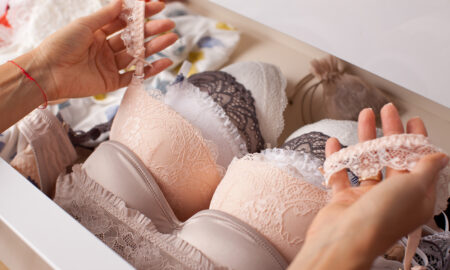 all-you-need-to-know-about-breast-implant-illness-woman-looking-at-bras