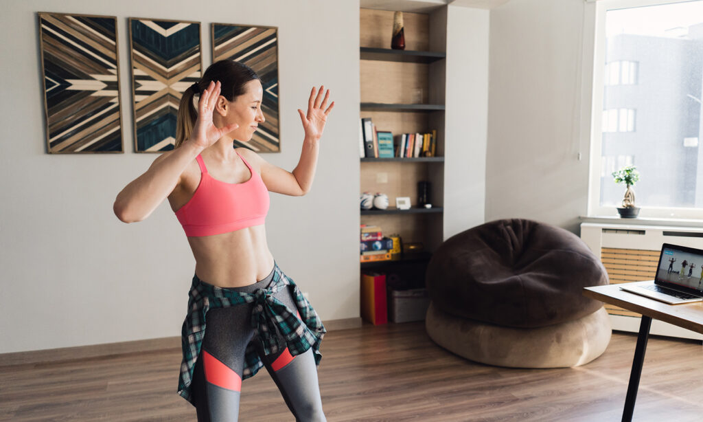 best-at-home-workouts-for-women-woman-working-out-in-her-living-room