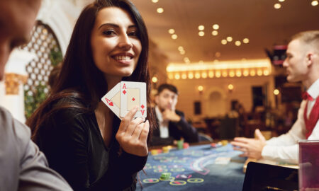 enjoy-online-casino-games-for-more-fun-at-home-girl-woman-at-casino-smiling