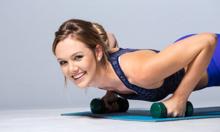how-to-increase-collagen-levels-cute-woman-smiling-at-camera-and-working-out