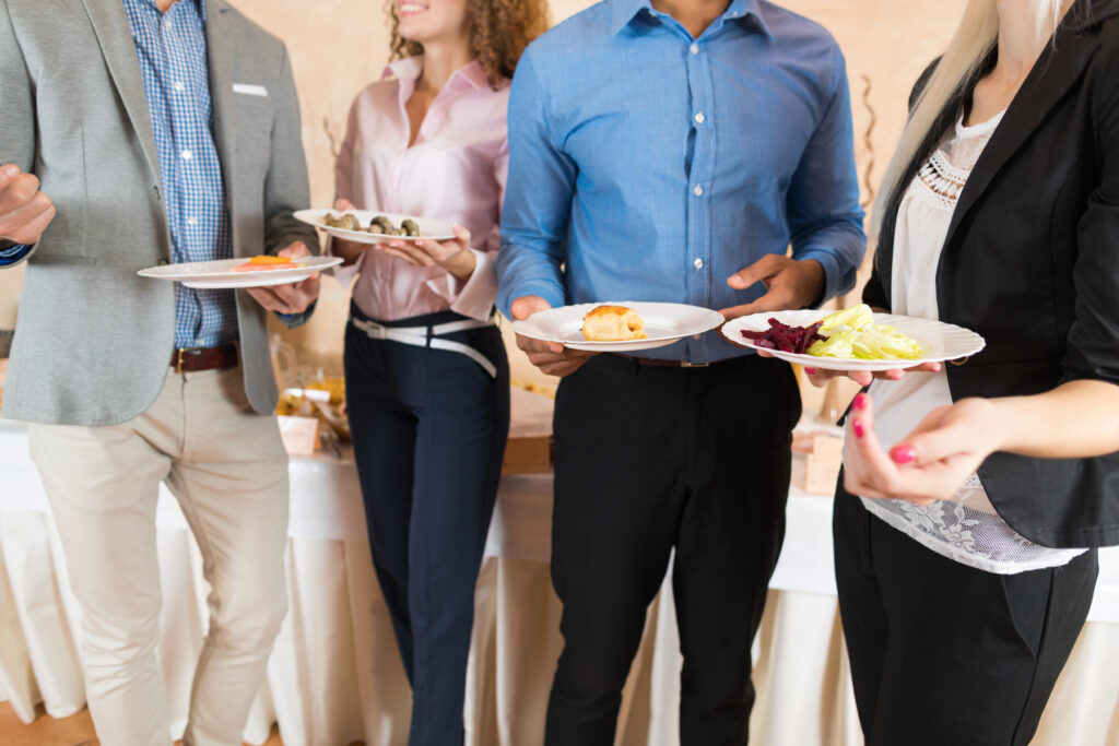 how-to-plan-a-successful-party-main-image-group-of-people-gathered-together-with-food