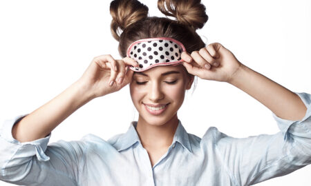 sleep-health-and-its-importance-total-body-wellness-woman-putting-on-sleep-mask