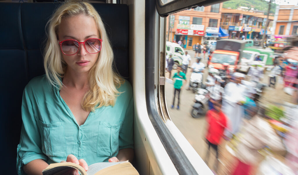 which-colors-look-best-on-blondes-woman-in-bright-colors-on-train