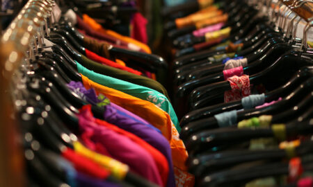 why-we-miss-in-person-shopping-colorful-clothing-on-rack-main-image